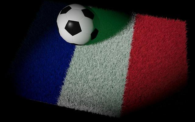 フランス国旗をイメージした芝の上にサッカーボールが置いてあるイラスト