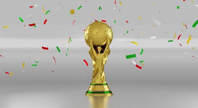 サッカーワールドカップのトロフィーと紙吹雪が舞っている画像