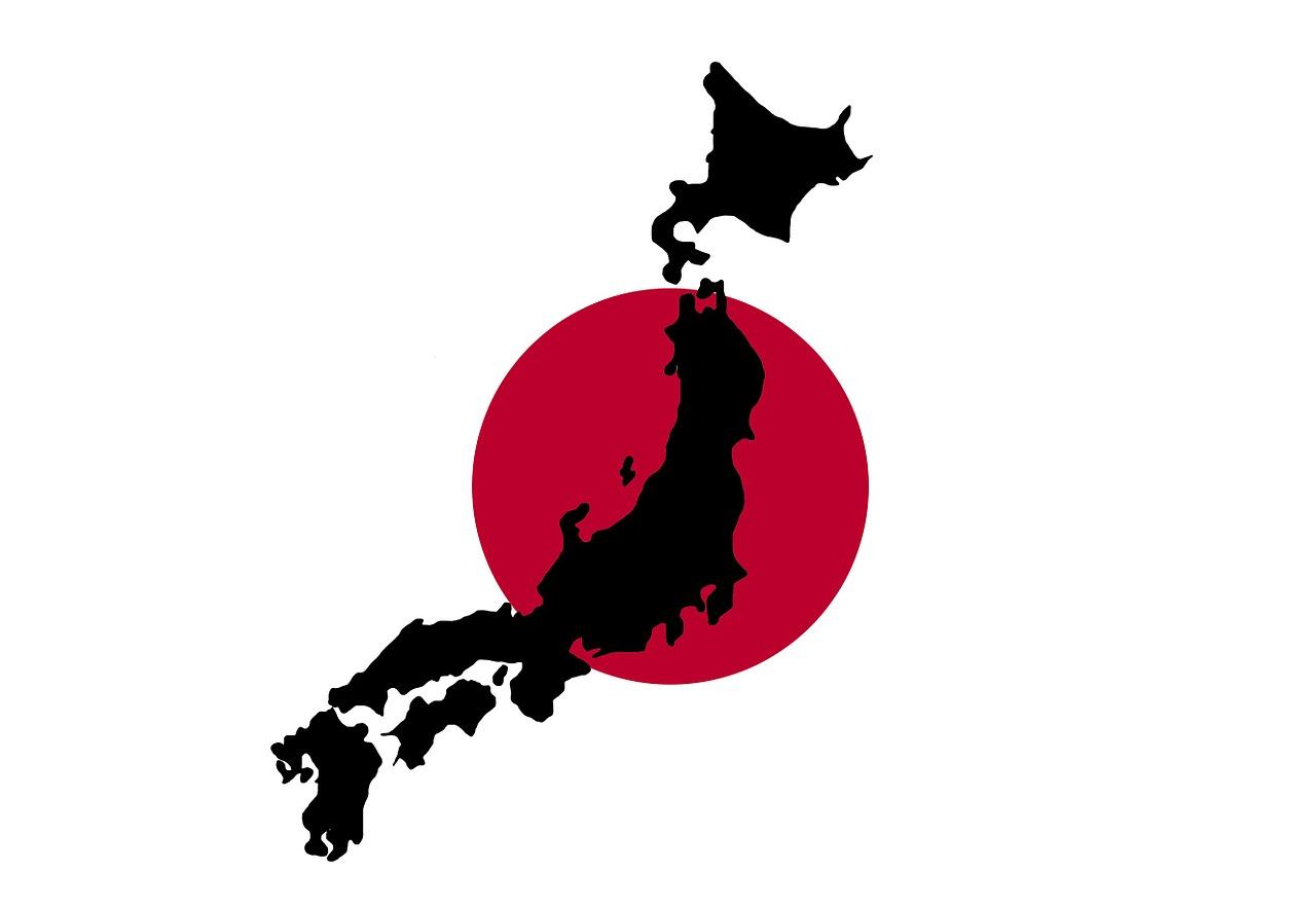 中央に赤い丸がある黒い日本地図のイラスト