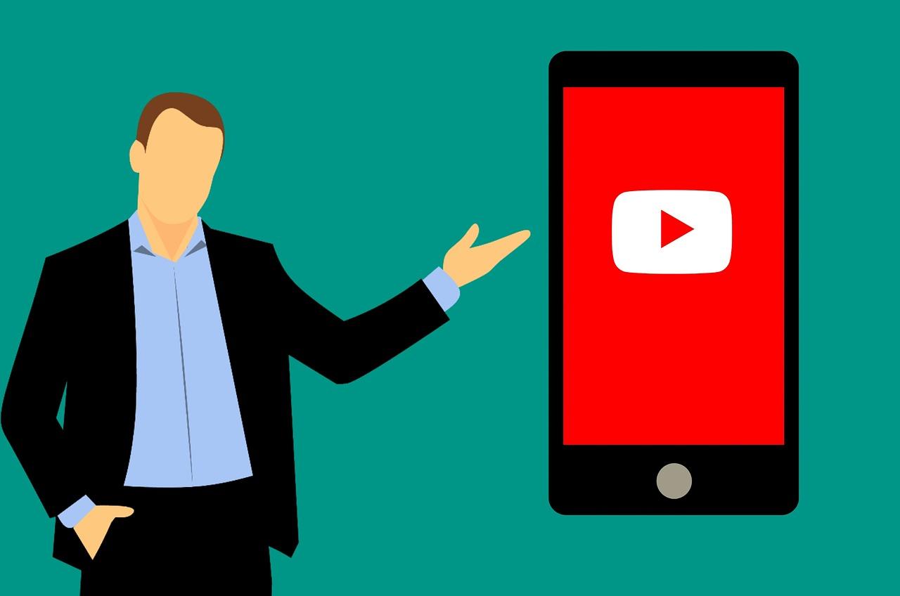 男性がスマートフォンに移るYouTube(ロゴ)を紹介しているイラスト