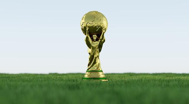 芝の上に置かれたサッカーワールドカップのトロフィーのイラスト