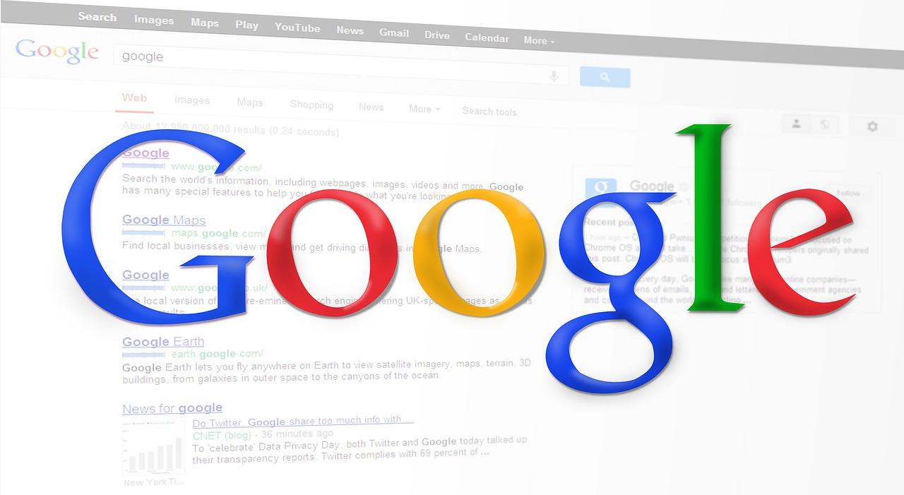 背景にインターネット検索結果が表示され、表面に大きくGoogleと文字が書かれている画像